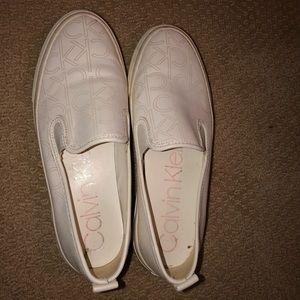 White Calvin Klein sneakers